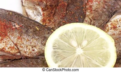 Fried carp with lemon - On a plate lie roasted in flour...