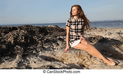 girl on beach rocks and stones sea