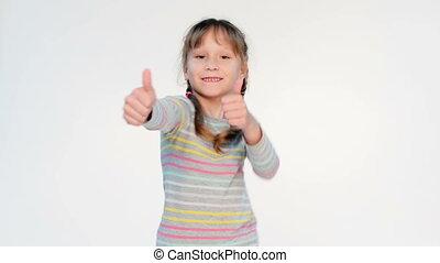 Success happy girl - Happy little girl dancing gesturing...