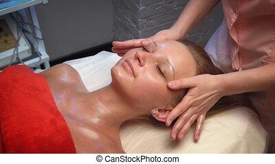 pretty woman receiving face massage - Face Massage. Close-up...