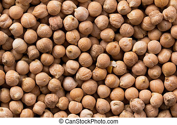 Placer chickpeas texture. Large scattering of chickpeas