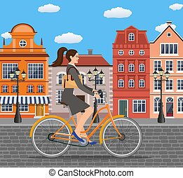 business lady riding on a cruiser bicycle.