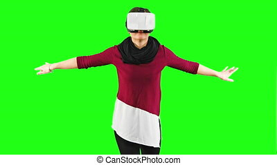 Woman Swimming with a VR Headset On.