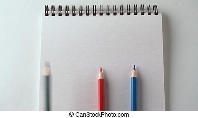 three different pencil writing question mark on a white...
