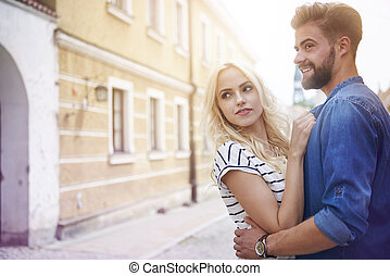 Young couple walking through the city street