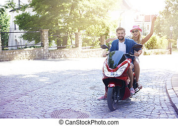 Loving couple riding a motorbike