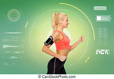 sporty woman running with smartphone and earphones - sport,...