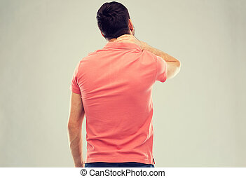man suffering from neck pain - people, healthcare and...