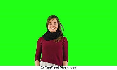 Woman Jumping Isolated on Green Background - Cute woman...