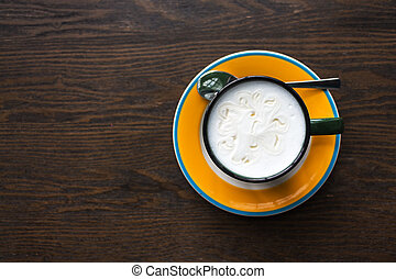 Top view of coffee cup on table.