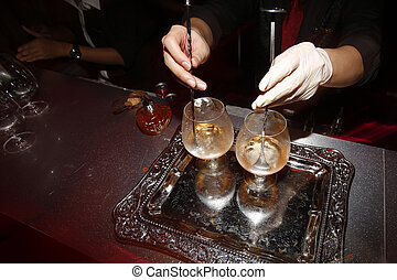 Bartender preparing alcohol for serving