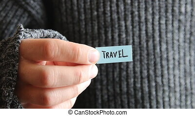 Travel - inscription on the tag - The guy holds a tag with...