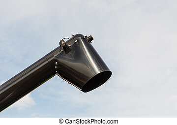 Black chute or drainpipe with sky in background - Plastic...