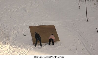 Women beaten out the carpet in the snow. Shot in 4K...