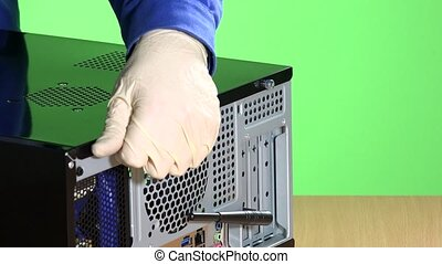 technician hands open computer case cover. pc repair...