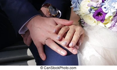 Newly wed couple's hands with wedding rings. Bride and groom...