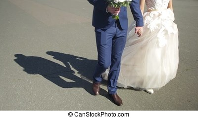 Young groom holding bride on hands and walking. Brides,...