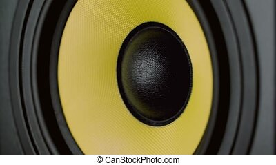 Close up at moving sub-woofer. Speaker part. Black and...