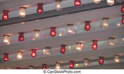 Fairground lights - Flashing red and white bulbs at a...