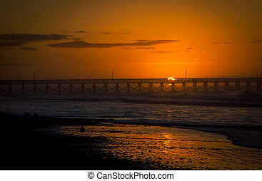 sunrise pier myrtle beach - Sunrise over a boardwalk in...