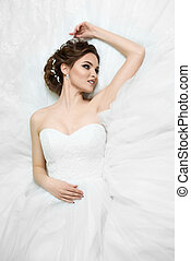 portrait of beautiful young bride in wedding dress