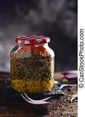 mason jar salad - a salad made with sweet corn, green peas,...