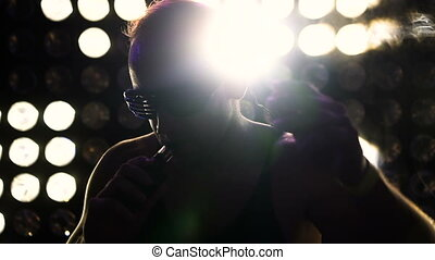 Man dancing at the party wearing neon led glasses - Handsome...