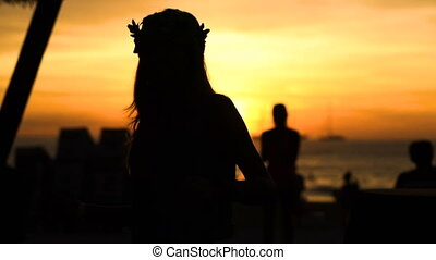 Happy woman dancing on the beach at sunset with sea...