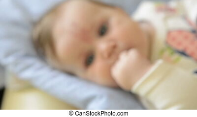 happy newborn baby girl - Extreme closeup face of a happy...
