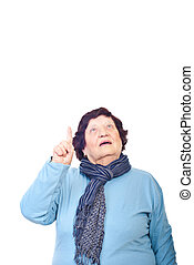 Senior woman pointing up - Senior woman looking and pointing...