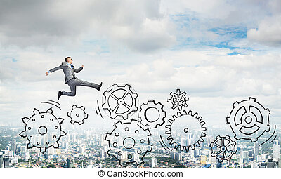 Businessman jumping high - Young businessman against city...