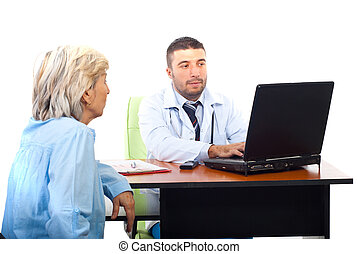 Doctor using laptop and having patient visit n his office
