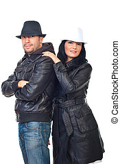 Beautiful couple of models in leather jackets and hats...