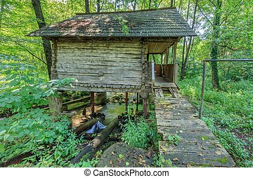 water mill - old historic water mill on Oltenia, Romania