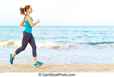woman goes in for sports jogging on beach