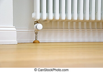 home improvement - modern radiator at the wall and parquet...