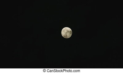 Moon on Cloudy Day - Mysterious night sky with full moon