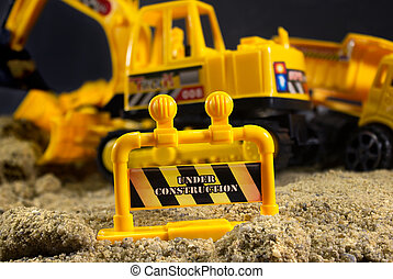 Under construction toy stop sign. - Construction warning...
