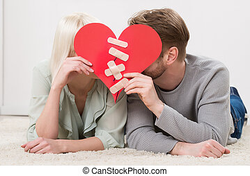 Couple Kissing Behind Heart Shape