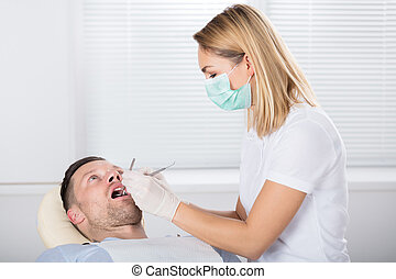 Oral Dental Checkup With Mirror