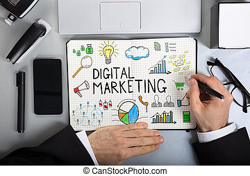 Businessperson Drawing Digital Marketing On Notebook -...