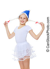 The girl gymnast in the hood Santa Claus. - Cheerful little...