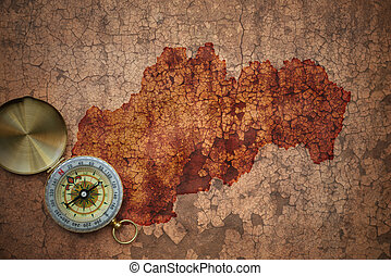 map of slovakia on a old vintage crack paper background with...