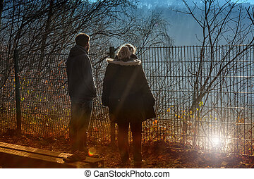 Man and woman are standing on a precipice - Two people on...