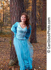 girl in medieval dress in autumn wood