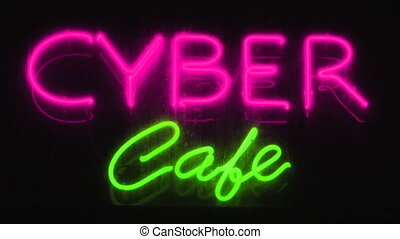 Cyber caf - Pink and green neon sign advertising an Internet...