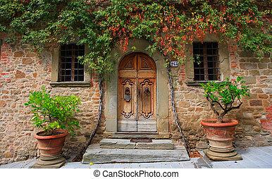 Old wooden door in Italy - wooden door with pots