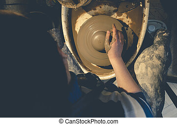 Top view of female potter at work