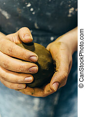 Potter hands kneading clay