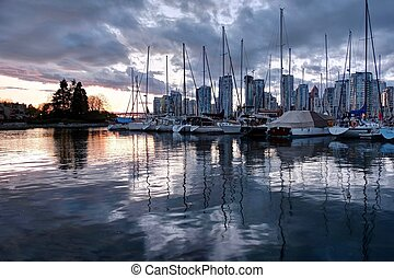 Vancouver skyline and harbor at sunset.